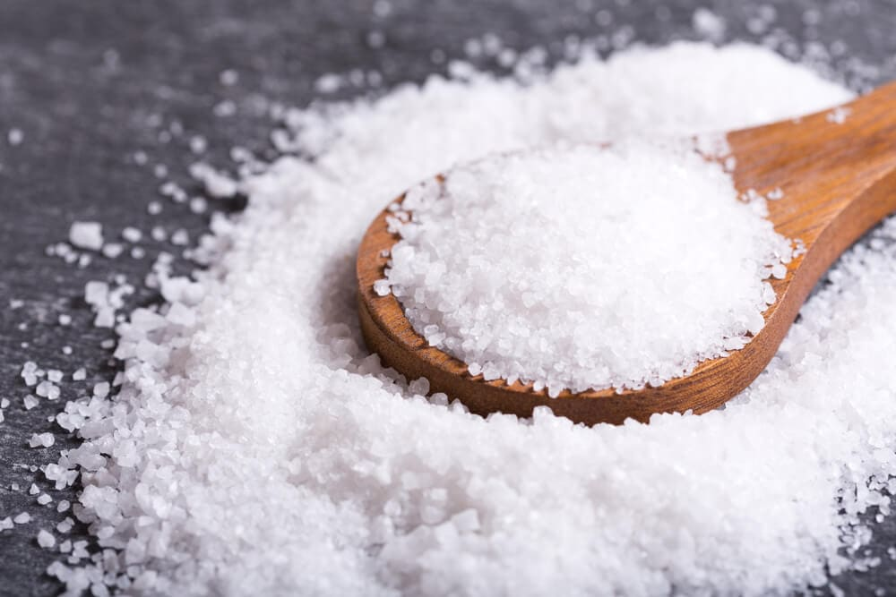 A picture of sea salt in a spoon.