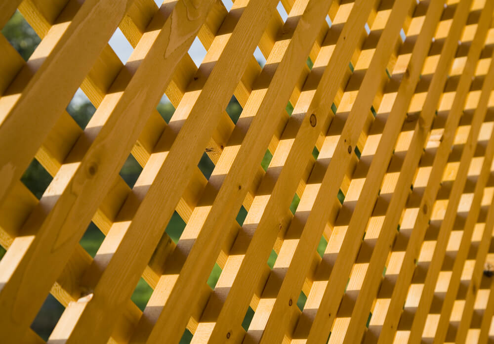 An image of a wooden lattice pattern fence.