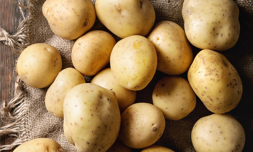 A picture of potatoes on a cloth placemat.