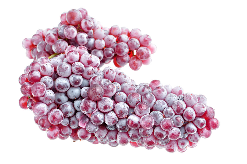 A picture of champagne grapes with a white background.